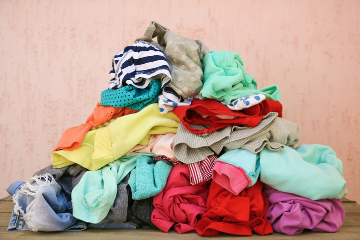 pile of clothing, several colors, sizes, and shapes